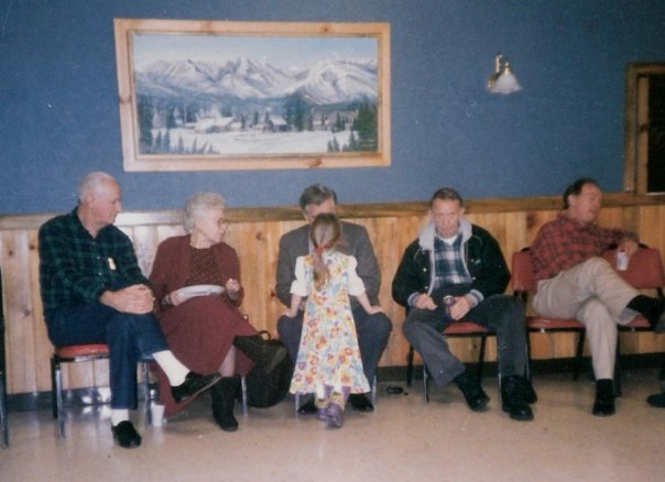 """Sam Fife's wife Lee sitting with Bill Grier speaking with an unknown child, then C.E. """"Buddy"""" Cobb, who became Sam Fife's predecessor, and Joe McChord"""